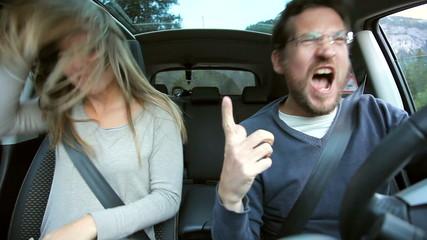Couple having fun dancing in car