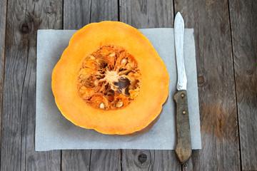 pumpkin on wooden board