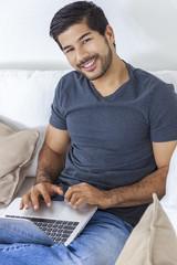 Asian Man With Beard Using Laptop Computer