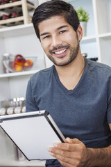 Asian Man With Beard Using Tablet Computer in Kitchen