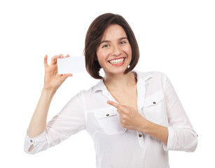 Cheerful young brunette showing a white business card