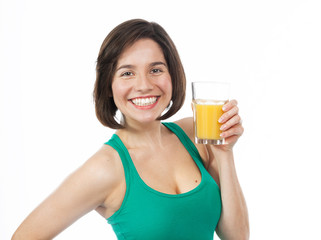 Cheerful young woman drinking an orange juice