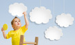 Kid with ladder attaching clouds to sky concept - 71364714