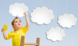 Kid with ladder attaching clouds to sky concept