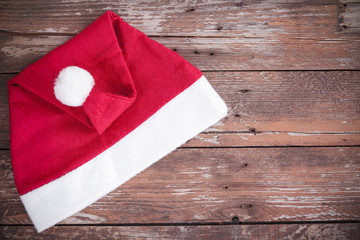 Santa claus hat on a wooden background
