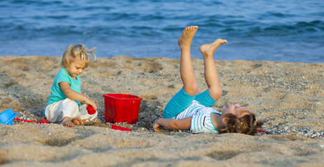 children at the seaside playing