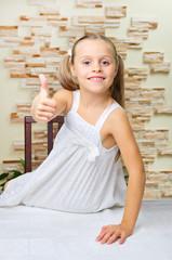 Little girl shows ok gesture