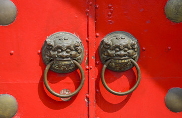 Red Chinese Door With A Lion Head.