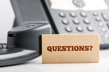 Small Signage for Questions on Telephone Desk