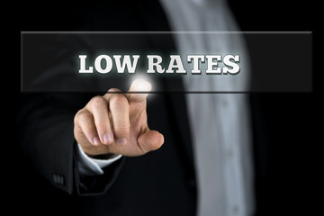 Businessman Pointing Low Rates on Transparent Box