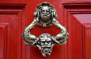 Old door knocker and red background