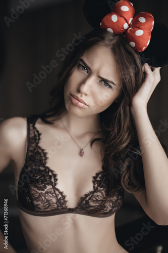 Beautiful brunette model in expensive lace lingerie Poster
