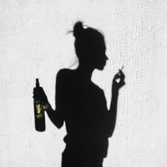 Shadow of girl smoking around on wall background
