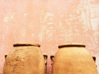 Clay amphoras near an old wall