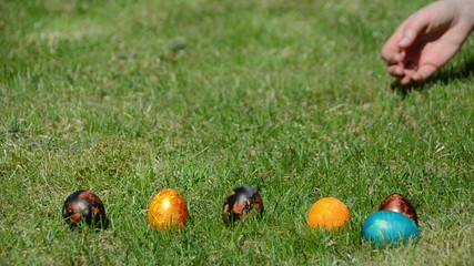Traditional family Easter game with painted colorful eggs