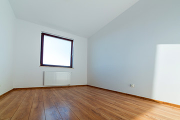 Apartment interior with wooden floor after renovation