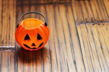 Halloween pumpkin background on wooden with a spider
