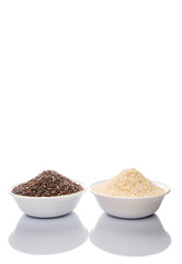 Black and white glutinous rice in bowl over white background