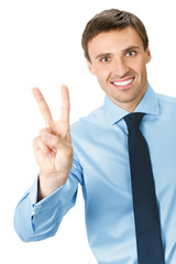 Happy smiling young business man showing two fingers or victory