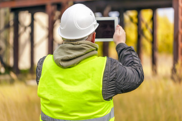 Engineer with tablet PC at outdoors