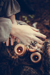 Girl's hands putting a spell over the candles