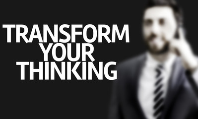 Business man with the text Transform your Thinking