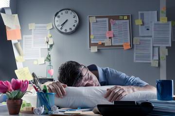 Businessman sleeping in the office overnight