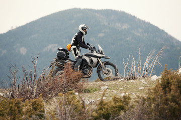 Man Driving a Motorcycle in Nature