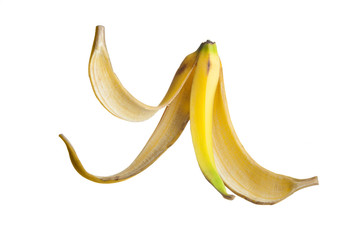 Banana peel floating on air against a white Background