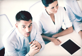 serious businessman on meeting in office