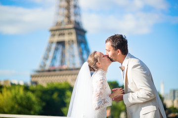 Bride and groom in Paris, near the Eiffel tower