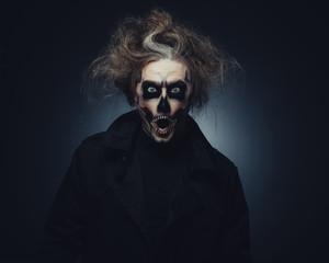 Portrait of man with Halloween skull makeup