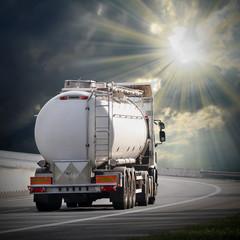 White tanker truck on the highway.