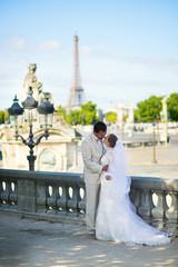 Bride and groom in the Tuileries garden of Paris