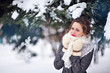 beautiful blonde woman walking outdoors under snowfall
