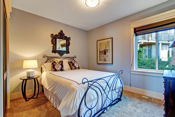 Bedroom with iron frame bed