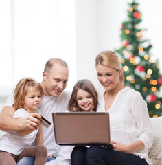 happy family with laptop computer