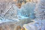 winter landscape with a river at sunset