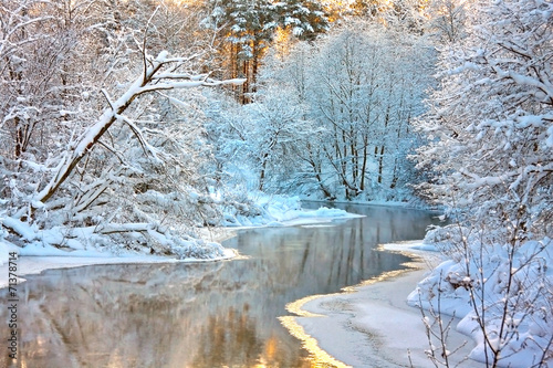 winter landscape with a river at sunset - 71378714