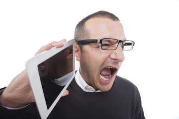 Businessman holding a table  and screaming.