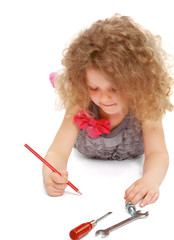 Happy little girl drawing with pencils at home