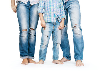 Family legs in tattered jeans