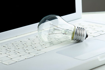 Light bulb and computer keyboard.