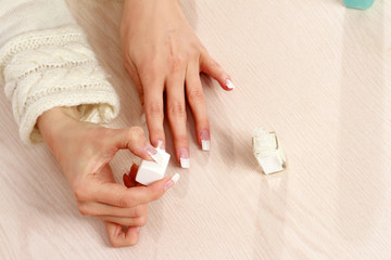 Beautiful woman hands with french manicure.