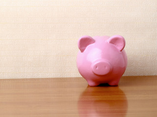 Piggy bank style money box isolated on a white background..