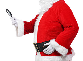 Santa Claus holding a magnifying glass