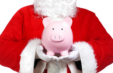 Close up of Santa Claus holding a piggy bank