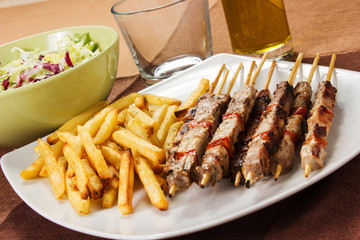 Pork skewers with french fries