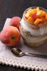 Healthy breakfast - yogurt with  fresh peach and muesli served