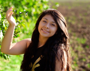 young smiling woman with green leaves